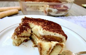 A piece cut from the completed tiramisu
